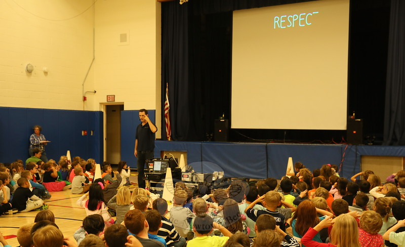 "Jamie Gannon of Prismatic Magic taught students how to sign the word ""respect"" during a laser show assembly at Middle Gate Elementary School on Friday, October 16.  (Hallabeck photo)"