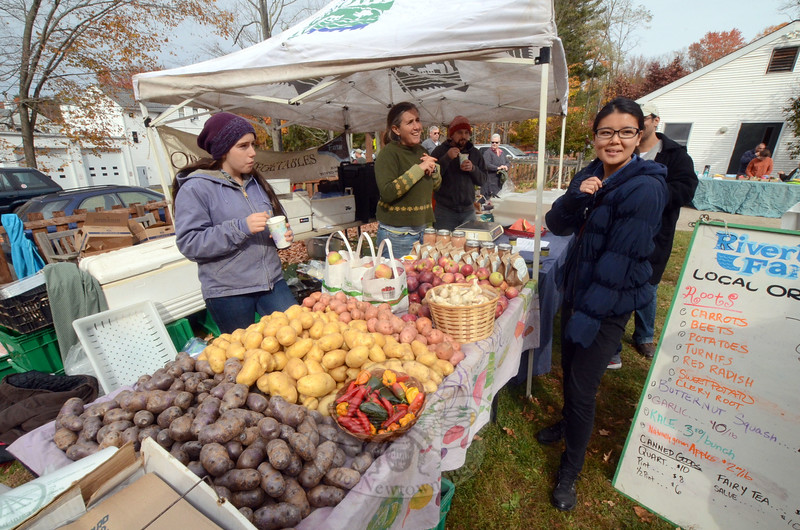 Lilly and Laura McKinney of Riverbank Farm and Whitney Flood of 9 Main staffed the mini-farm stand at the Waldorf Fall Fair & Craft Market at the Housatonic Valley Waldorf School in Dodgingtown. (Voket photo)