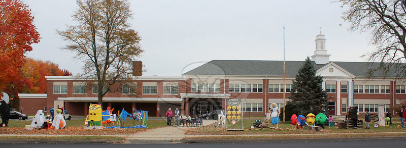 By Saturday, October 23, an impressive array of 31 sculptures was on view on Newtown Middle School's front lawn. (Hicks photo)