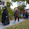 Donning an eerie cowl, Martha Bishop wove together tales from folk lore and actual haunted happenings as she led two Main Street Ghost Walks October 17 from the local Historical Society and Matthew Curtiss House. The comparatively tiny groups of around a dozen were a precursor to Hal-loween night when thousands of costumed revelers arrive on Main Street to make the rounds. (Voket photo)