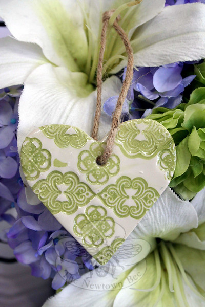 Small polymer clay hearts created by Maryland artist Laurel Boyd are being offered for sale as part of a fundraiser for Newtown Lions Club's Sandy Hook Elementary Fund. The 2¾ by 2¾-inch ornaments are $10 each. (Hicks photo)