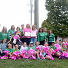 "Sandy Hook Sole Sisters members and their children have begun their third annual fundraising campaign. The ""Tie the Town Pink"" effort includes hanging large handmade pink bows throughout the community and is a special gesture to friends and family affected by the disease. One of the first ribbons put in place this year was on the decorative cow at the entrance to Holy Cow Ice Cream on Church Hill Road. From left, in back, are Aimee Tabor, Tracy Hoekenga, Grace Ruggiero, Beth Hegarty, Annie Haddad, Adrian Dandrea, Gina Bradbury, Heidi Werner, and Mai Tran; in front, Kyle Tabor, Charlie Haddad, Trey Hoekenga, Nichole Tabor, Braeden Wong, Matt Hoekenga, Meghan Hegarty, Brandon Wong, Shannon Hegarty, Julia Bradbury, CJ Hoekenga, Jackie Hegarty, and Jake Dandrea. (Bobowick photo)"