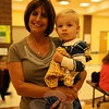 Newtown Parent Connection Co-Founder Dorrie Carolan held her grandson Colin Scholz during his first Family Fun Night, Friday, September 25. (Hallabeck photo)