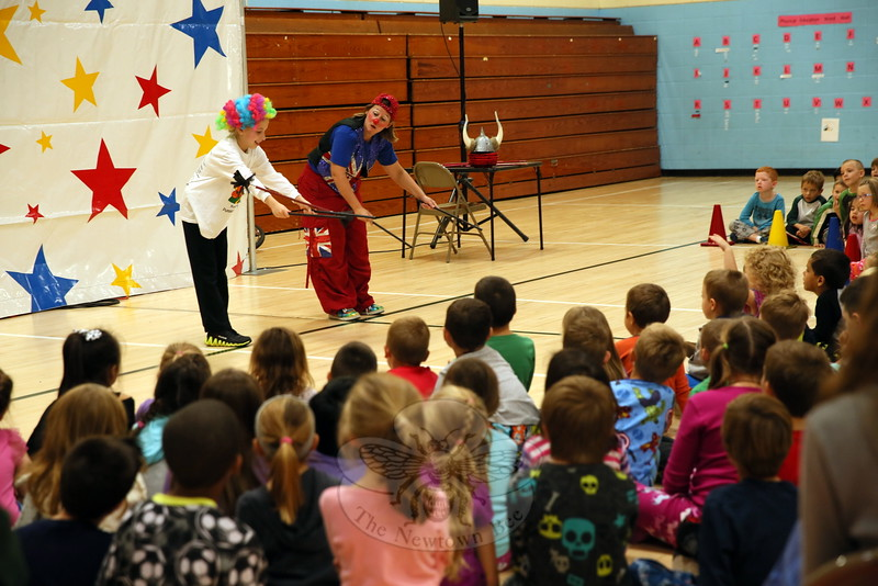 Sandy Hook student Lauren Milgram, left, learned how to use juggling sticks from National Circus Project's Lou Beekhuizen during a school presentation on October 2. (Hallabeck photo)