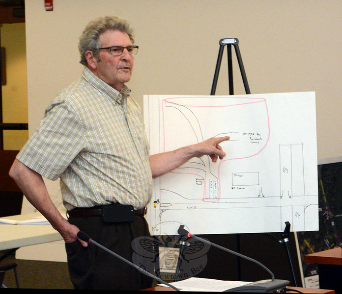 Resident Patrick Napolitano of 13 Whippoorwill Hill Road, displaying a sketch he had drawn, explains some of his traffic-flow concerns about a proposed mixed-use development in Hawleyville, which would include a 180-unit rental apartment complex, a diner, and a church. Mr Napolitano spoke at an October 1 Planning and Zoning Commission public hearing. (Gorosko photo)