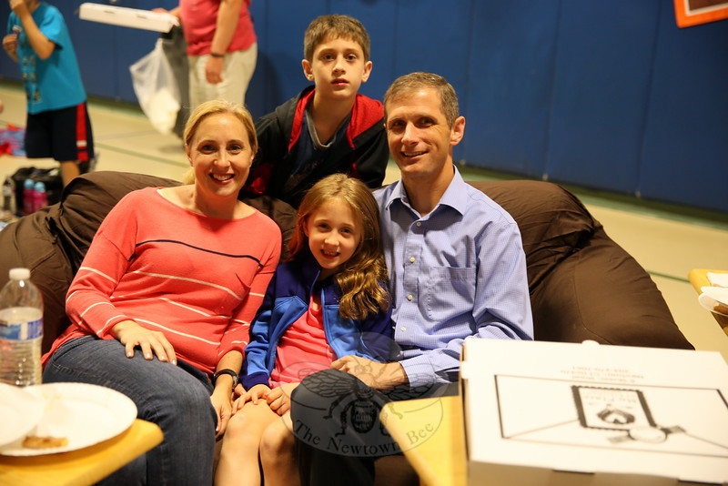 The Boughan family won the right to sit in a sofa through a raffle during Hawley Elementary School's Indoor Movie Night, held on Friday, September 25. Pictured are mom Allison, daughter Gillian, son Kyle, and father Kevin. (Hallabeck photo)