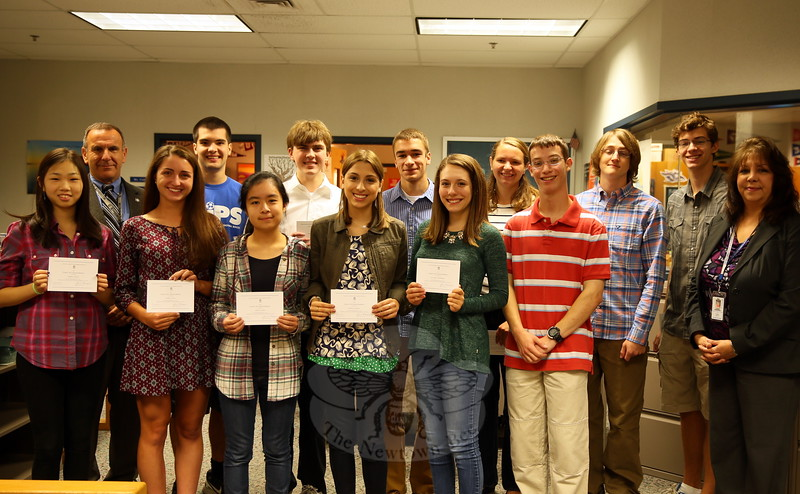 Superintendent of Schools Joseph V. Erardi, Jr, back left, and Newtown High School Principal Lorrie Rodrigue, front right, recognized students on Friday, September 25, who were named as Commended Students in the National Merit Scholarship Program and two students named as National Merit Scholarship Program Semi-Finalists, Matthew Ingwersen and Caelan Ritter. Commended Students, not pictured in order, are Scott Alexander, James Frazzetta, Ashley Gong, Brendan Gregory, Gemma Hyeon, Abigail Kohler, Sean MacMullan, Josefina Mendez, Marissa Thill, and Natalie Zimmerman. (Hallabeck photo)