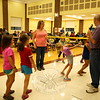"Children did the limbo while DJ Kevin ""Music Man"" Koschel, right, and wife Beth Koschel held the limbo stick during the annual Family Fun Night, held on Friday, September 25. (Hallabeck photo)"