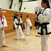 Porco's Karate Academy instructor Mystic Higginson works with young students, from left, Isabella Tourigny, Christopher Lund and Ken Ballard during the Annual Health & Safety Fair at the Newtown Middle School. (Voket photo)