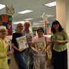 The Spay and Neuter Association of Newtown (SNAN) recently donated 15 books about animals to C.H. Booth Library's Children's Department in memory of Penelope Meek, who was president, treasurer, Ways and Means chair, and a member of SNAN for many years. Ms Meeks also coordinated the Cat Clinics in Newtown for many years and was devoted to assisting pet owners to receive help in spaying and neutering their animals, according to SNAN. SNAN members, from left, Gloria Ricco, Barbara Lynch, John Stott, and Marion Thompson, posed for a photo with some of the books and library Director Brenda McKinley on Wednesday, September 16. (Hallabeck photo)