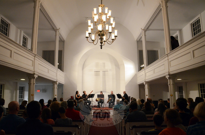 "An appreciative audience attended one of the early Newtown Arts Festival events September 11 at Newtown Meeting House, and was not disappointed by a packed program of entertaining and eclectic selections. ""Random Acts Of Chamber Music"" featured performances by The Danbury Trombone Outfit and The New England New Music Ensemble (NENME). NENMA members are, from left, Kristen Provost Switzer on cello, Scott Switzer on bassoon, Emily Boyer on horn in front, Gregg Baimel on saxophone, Robert Rabinowitz on flute, and Phil Crevier on piano (not pictured). (Voket photo)"