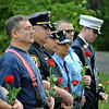 Firefighters from area towns contemplate the words of speakers during the September 11 memorial service. (Crevier photo)