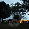 As daylight faded on Saturday, guests of the Newtown Forest Association Sunset Wine Tasting crowded beneath tents filled with soft light. In brighter areas, servers prepared trays of food for the 300 guests attending the second annual fundraiser. (Bobowick photo)