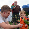The Newtown Arts Festival was a great way for young people to get out and interact, whether it was visitors like 2½-year-old Liliana from Danbury, who added her artistic touches to a giant banner, 2-year-old Charlie, who got up close with Pepe the parrot and handlers Chris Leon and his dad, Wade, shown, or members of the Graceful Planet ensemble who were performing for a large audience Saturday morning. (Voket photo)