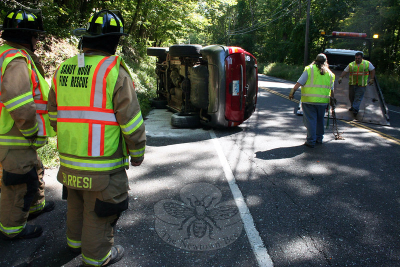 Police report a two-vehicle accident on Berkshire Road, near Sherman Street, about 1 pm on Septem-ber 14. Police said motorist Melissa Beard, 34, of 93 Berkshire Road, who was driving a 2004 Jeep Grand Cherokee SUV eastward, was attempting to make a left turn to enter a driveway, when the Jeep's left side was struck from behind by eastbound motorist Michael Dzujna, 49, of Shelton, who was driving a 2000 GMC Sierra pickup truck. Beard received injuries in the accident and was transported by ambulance for treatment, officials said. Sandy Hook volunteer firefighters responded to the accident. The accident is under investigation, police said. (Hicks photo)