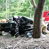 Motorist Jill Masten, 47, of 88 Forest Drive was driving a 2006 Saab 9-3 sedan eastward on Berkshire Road, near Zoar Road, about 9:48 am on September 13, when the vehicle veered off the right road shoulder and struck a tree, police said. Sandy Hook volunteer firefighters removed a door from the auto to extricate the driver. The Newtown Volunteer Ambulance Corps transported Masten to Danbury Hospital for treatment of injuries, police said. The accident is under investigation, according to police. (Hicks photo)