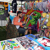 Exhibitor vendors like Kaye Bishop of Bozrah and Richie Nigro of Bethel, shown, converged on the Newtown Arts Festival last Saturday to display their talents among the dozens of visual artists and crafts people who turned out for the second annual event at Fairfield Hills. (Voket photo)