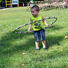 Jace Yeager attempted to hula-hoop on Saturday during the Choose Love Outdoor Concert Series event. Joy Hoffman of The Joy of Art, Healing Newtown, offered the hula hoops and other activities near a tent set up for the event. (Hallabeck photo)