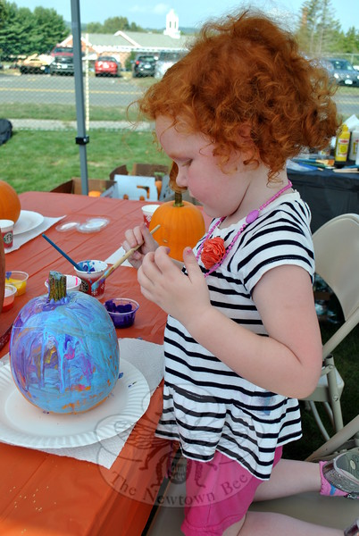 Many activities were offered during the first day of the Newtown Arts Festival signature outdoor event on Saturday, September 20. Juliette Britton painted a pumpkin at one station. (Hallabeck photo)