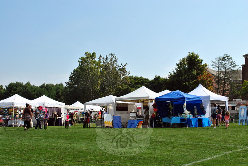 Tents set up for the first day of the 2015 Newtown Arts Festival, as viewed from an open space on what is traditionally used as a soccer field. The festival was presented in the large open space surrounded by Trades Lane and Keating Farms Avenue. (Hallabeck photo)