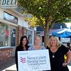 From left is Newtown Savings Bank Public Relations Coordinator Kathryn Ascenzi, SHOP Treasurer Sharon Doherty, and NSB PR Director Tanjua Damon Truaxx. The ladies are standing on the sidewalk shared by three Sandy Hook businesses, which will be a hub of activity during the upcoming 5th Annual SHOP Passport To Sandy Hook event. Newtown Savings Bank has signed on as the event's Title Sponsor, and has also donated a grand prize for one of three gift packages that will be given away on October 10. (Hicks photo)