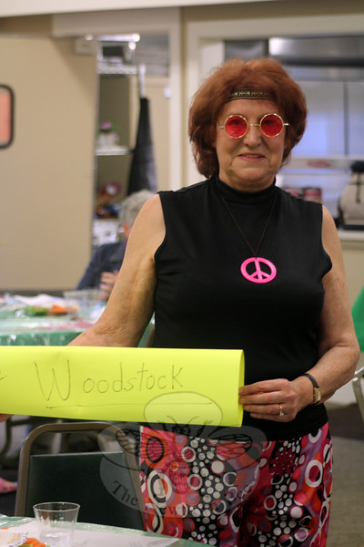Jayne Turner wasn't able to find a ride to Woodstock last week, but she did find her way to the Community Building at Nunnawauk Meadows for Retro Fest. Other attendees were seen wearing some very big bell bottom pants, summer hats, and even a flapper-style headband. (Hicks photo)
