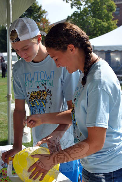 Allie Paynter and Ryan Patrick worked to create a lantern during the first day of the Newtown Arts Festival signature outdoor event on Saturday, September 20. (Hallabeck photo)