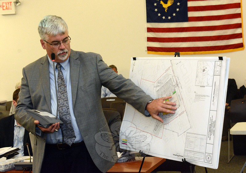 Engineer James Cassidy of Hallisey, Pearson & Cassidy Engineering Associates, Inc, of Rocky Hill, representing a real estate firm that wants to build a Tractor Supply store at 116 South Main Street, describes a site plan for the property at a September 17 Planning and Zoning Commission public hearing. (Gorosko photo)