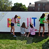 A group worked to help paint a sign at the Ben's Lighthouse tent during the first day of the Newtown Arts Festival signature outdoor event on Saturday, September 20. (Hallabeck photo)