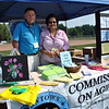 Curt Symes and Sheila Torres oversaw the Commission on Aging tent during the first day of the Newtown Arts Festival signature outdoor event on Saturday, September 20. (Hallabeck photo)