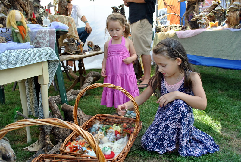Sisters Vivian, back left, and Rusa Ellul looked at some of the offerings at the Fairy Houses By Yolie tent at the Newtown Arts Festival on Saturday, September 20. (Hallabeck photo)