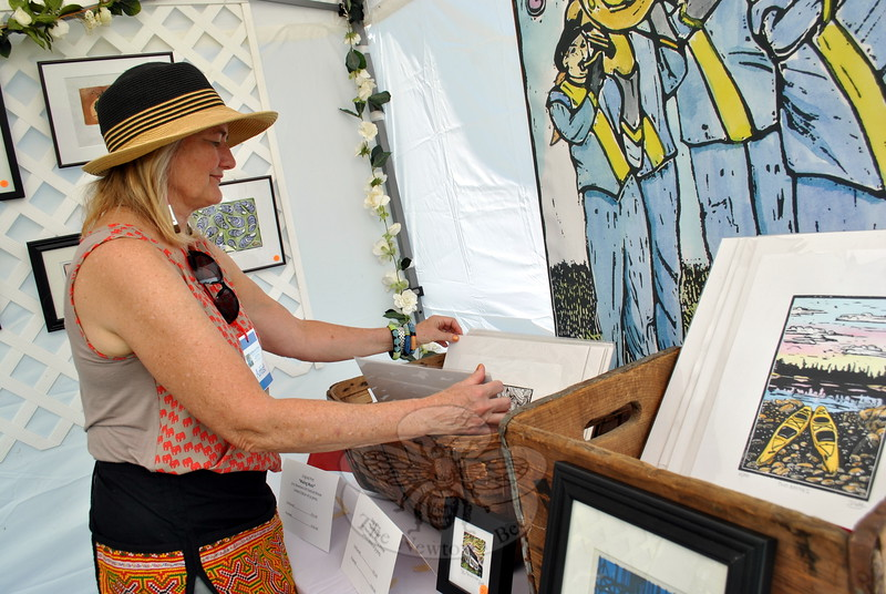 Resident and artist Tracy Van Buskirk set up her tent on Saturday, the first day of the Newtown Arts Festival signature outdoor event. (Hallabeck photo)