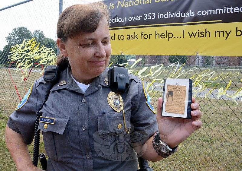 It has been 25 years since Newtown Police Officer Maryhelen McCarthy's youngest brother Dan committed suicide, and she still carries a copy of his obituary with her. Ms McCarthy is working to encourage Newtowners to know the warning signs and to talk about suicide, especially between September 7 to 13 — National Suicide Prevention Week, surrounding World Suicide Prevention Day, September 10. (Voket photo)