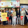 A number of community officials including First Selectman Pat Llodra joined Consumers Petroleum President Christine Hogan on the big scissors for a ribbon cutting and grand opening event at the company's 20th Wheels gas and convenience store at the intersection of Church Hill and Edmond Roads August 28. Festivities included Wheels staffers offering sandwiches and milk shake samples to visiting patrons behind the wheel, and temporarily dropping the price of regular gas to $2.29, attracting a caravan of vehicles lining up for a less expensive fill-up.  (Voket photo)