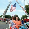 Marcella Stapleton, left, and Debbie Aurelia Halstead were among the hundreds of people who lined the CT United Route this year. The event is both a 9/11 tribute and fundraiser for family emergency relief funds for local police officers and fire department members, and two United Way chapters. (Bobowick photo)
