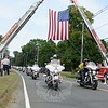 Police bikes from regional towns and cities including Trumbull and Hamden led the more than 2,000 motorcycles participating in the CT United Ride on Sunday, August 30. Riders and their passengers were cheered on by spectators who lined the roads of the 60-mile route, including a section of South Main Street near Borough Lane. Hook & Ladder and Sandy Hook firefighters had a large American flag strung between their ladder trucks, creating an arch under which the motorcycles passed for the 15th year. (Bobowick photo)