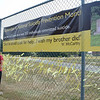Newtown Police Officer Maryhelen McCarthy and Newtown Health District Director Donna Culbert stand beside a banner at Fairfield Hills reminding residents that in 2014, more than one person each day committed suicide in Connecticut. The banner is bordered by 353 yellow ribbons representing those victims, a number both Ms McCarthy and Ms Culbert fear may be significantly understated. (Voket photo)