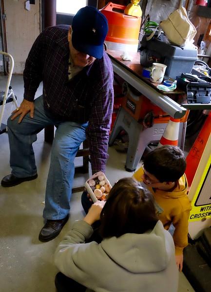 Deborah, John's wife, treats the whole crew to a selection of donut hole snacks.