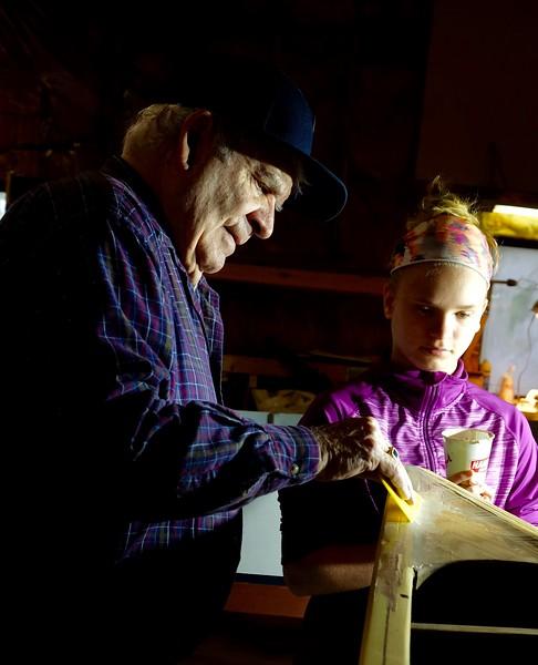 Kristina ensures Roger always has enough material.