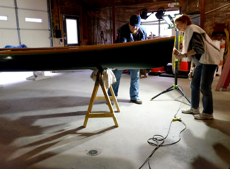 Roger, the canoe restoration leader, does the final inspection as Mary looks on. Mary ably stepped into Phase I mentor Frank Campisi's shoes  while he remained down south for the winter. <br /> <br /> Next time you see Bob Katz' old fiberglass canoe, it will be fully restored and proudly on display at South Cove.