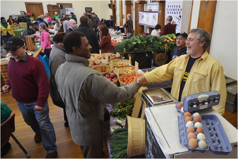 Alphonse Knight, the building manager at Second Church in Dorchester,  Codman Square, greets Scott Hurwitz pf Silver Brook Farm in Dartmouth, MA.
