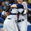 Cleveland Indians pitcher Joe Smith, right, embraces catcher Carlos Santana after Toronto Blue Jays' Edwin Encarnacion grounded out to third during the 11th inning of a baseball game in Toronto on Wednesday, April 3, 2013. The Indians won 3-2. (AP Photo/The Canadian Press, Chris Young)