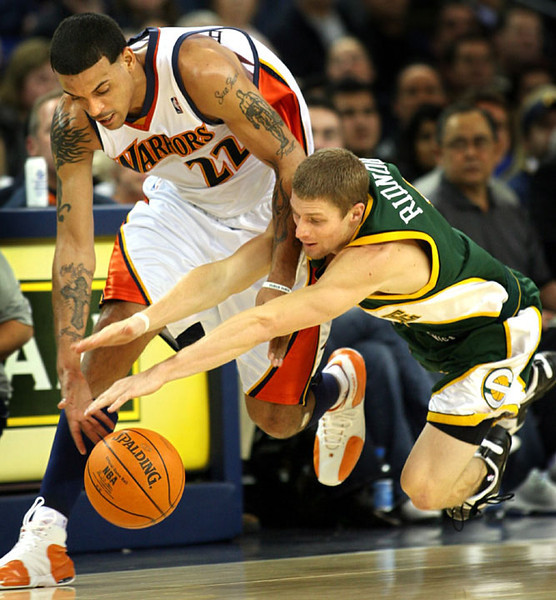 Golden State Warriors'  Matt Barnes battles the Seattle Supersonics' Luke Ridnour for a loose ball in the second quarter of an NBA basketball game,  Saturday, Jan. 6, 2007 in Oakland, Calif.  AP Photo/Dino Vournas