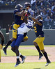 California's Sean Cattouse, left, intercepts a pass intended for Presbyterian's Anderico Bailey, with Cal's Marc Anthony, right, defending, in the first half of an NCAA college football game, Saturday, Sept. 17, 2011 at AT&T Park in San Francisco.  (AP Photo/Dino Vournas)