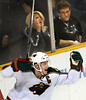 Minnesota Wild's Mikko Koivu of Finland celebrates as fans anguish after he scored the winning goal against the San Jose Sharks in the waning seconds overtime of an NHL hockey game,  March 5, 2009 in San Jose, Calif.  (AP Photo/Dino Vournas)