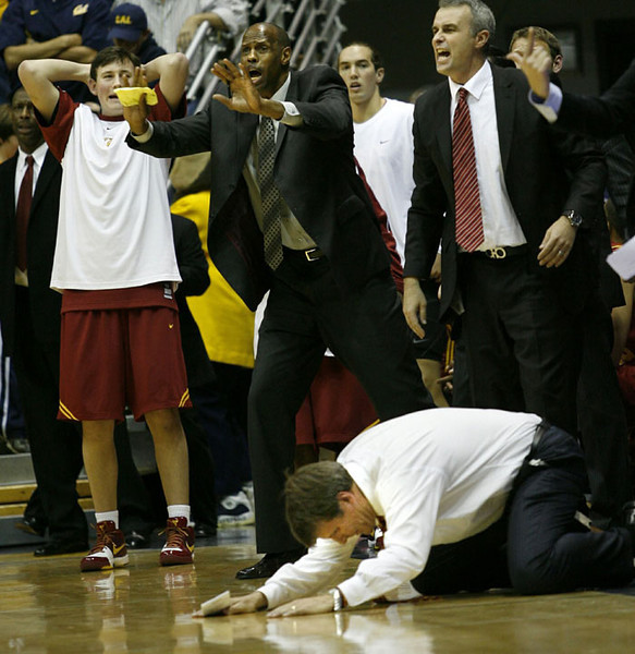 Southern California's head coach Tim Floyd hits the floor in anguish after California took the lead in overtime, eventually winning 81-78 in an NCAA basketball game, Feb. 26, 2009 in Berkeley, Calif.  AP Photo/Dino Vournas