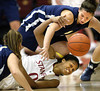 Stanford's Melanie Murphy (0) and Vanguard's Diana Neves, top, fight for a loose ball in the first half of an NCAA women's pre-season basketball game, Friday, Nov. 7, 2008 in Stanford, Calif.  AP Photo/Dino Vournas