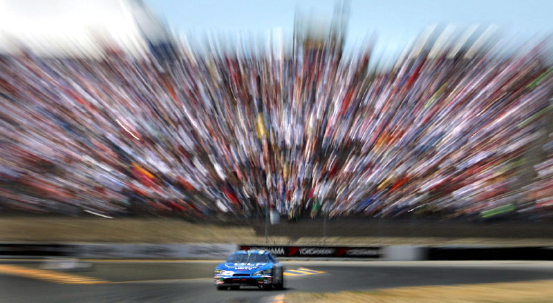 Tony Raines, in the #96 DLP Technology Chevy Monte Carlo, comes out of turn 7 during the  Dodge/Save Mart 350 auto race, part of NASCAR's Nextel Cup series, at Infineon Raceway, Sunday, June 25, 2006 in Sonoma, Calif.  AP Photo/Dino Vournas