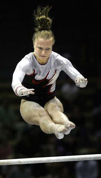 The University of Utah's Nicolle Ford performs on the  uneven bars  during the NCAA Western Regional Womens Gymnastics meet in Haas Pavilion at the Universty of California in Berkeley, 4/14/07:  AP Photo/Dino Vournas