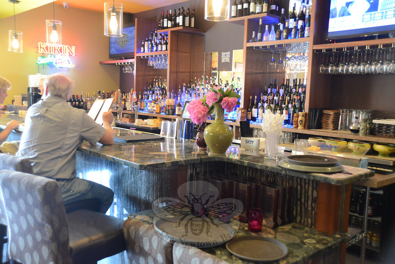 Among the several dining rooms at Fusion 25 is a separate bar area where fresh drinks are served.  (Bobowick photo)